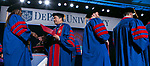 A. Gabriel Esteban, Ph.D., president of DePaul University, hands out diplomas and congratulates the graduates during the College of Law commencement ceremony, Sunday, May 13, 2018, at the McCormick Place Grand Ballroom in Chicago, IL. Approximately 280 students received their Juris Doctors or Master of Laws degrees during the event. (DePaul University/Jamie Moncrief)