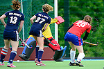 Mannheim, Germany, May 09: During the Regionalliga Sued Damen match between Feudenheimer HC (red) and TSV Schott Mainz (dark blue) on May 9, 2015 at Mannheimer HC in Mannheim, Germany. Final score 3-0 (1-0). (Photo by Dirk Markgraf / www.265-images.com) *** Local caption ***