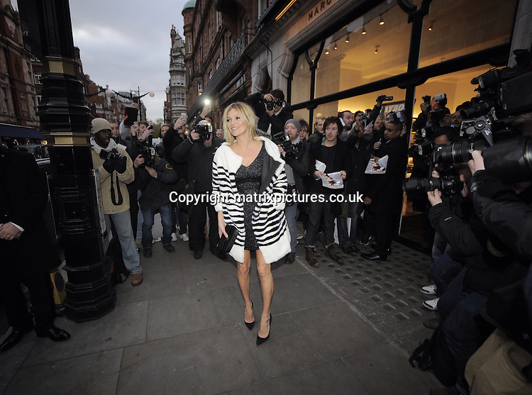 NON EXCLUSIVE PICTURE: MATRIXPICTURES.CO.UK<br /> PLEASE CREDIT ALL USES<br /> <br /> WORLD RIGHTS<br /> <br /> English supermodel and media personality Kate Moss is pictured as she arrives at the Central London Marc Jacobs store ahead of the launch of her cover shoot for the 60th anniversary edition of Playboy.<br /> <br /> DECEMBER 2nd 2013<br /> <br /> REF: PSE 137711