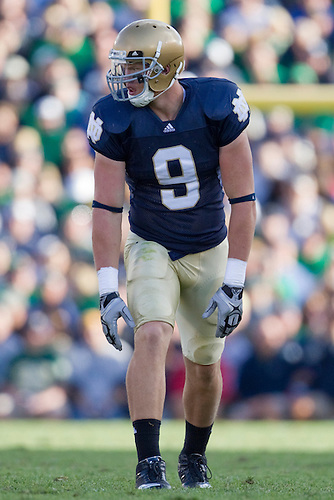 Notre Dame tight end Kyle Rudolph (#9) lines up for play in game action during NCAA football game between the Notre Dame Fighting Irish and the Purdue Boilermakers.  Notre Dame defeated Purdue 23-12 in game at Notre Dame Stadium in South Bend, Indiana.