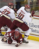 Patrick Alber (BC - 27), T.J. Syner (UMass - 14), Jimmy Hayes (BC - 10) - The Boston College Eagles defeated the University of Massachusetts-Amherst Minutemen 6-5 on Friday, March 12, 2010, in the opening game of their Hockey East Quarterfinal matchup at Conte Forum in Chestnut Hill, Massachusetts.