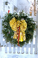 Residential fence decorated with Christmas wreath. St Paul Minnesota USA