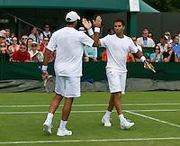 England, London, 25.06.2014. Tennis, Wimbledon, AELTC, Jean-Julien Rojer (NED) with his doubles partner Horia Tecau (ROU) (L)<br /> Photo: Tennisimages/Henk Koster