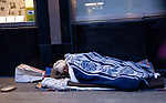 A  woman sleeps in a comercial street in Madrid during a winter cold wave. 08/02/2012