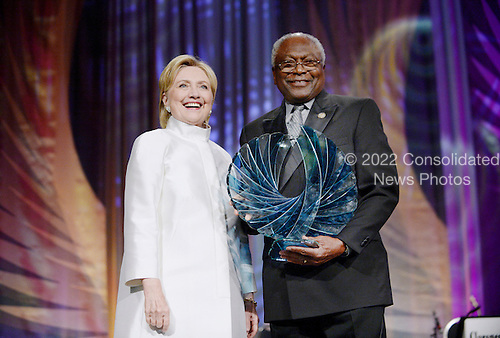 Former United States Secretary of State Hillary Clinton, the 2016 Democratic Party nominee for President of the United States, receives the Phoenix Award from US House Assistant Democratic Leader Jim Clyburn (Democrat of South Carolina) during the Congressional Black Caucus Foundation's 46th Annual Legislative Conference Phoenix Awards Dinner at the Washington Convention Center, September 17 2016, in Washington, DC. <br /> Credit: Olivier Douliery / Pool via CNP