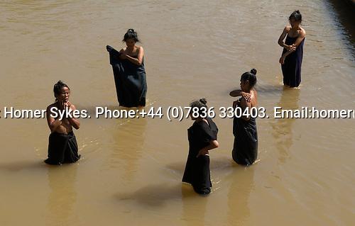In Dein or Indein village. Inle Lake. Myanmar (Burma.) 2006. Women washing in the river.