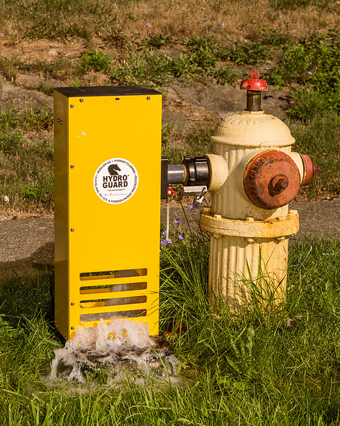 August 7, 2016. Flint, Michigan.<br /> Since residents still are not using the city water, many hydrants in the city are opened and flushing to keep the water moving through the system, avoiding issues with stagnant water. <br />  In April 2014, the city of Flint switched its water source from the Detroit Water and Sewerage Department to using the Flint River in an effort to save money. When the switch occurred, the city failed to have corrosion control treatment in place for the new water. This brought about a leaching of lead from pipes into the water, increasing the lead content in the drinking water to levels far above legal limits. After independent sources brought this to light, the city admitted the water was unsafe and legal battles have ensued between resident and the local and state governments.