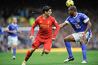 28.10.2012 Liverpool, England. Luis Suarez  of Liverpool and Sylvain Distin   in action during the Premier League game between Everton and Liverpool  from Goodison Park ,Liverpool