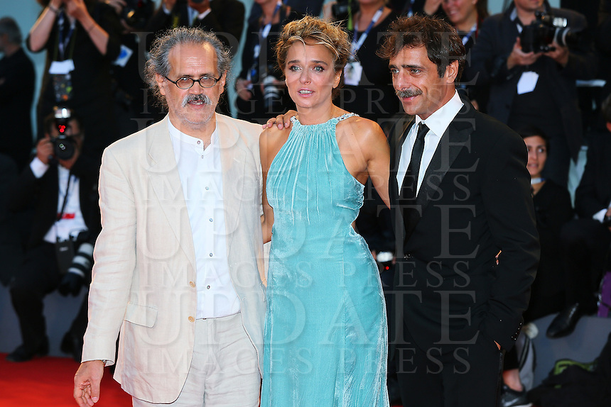 From left, Giuseppe Gaudino, Valeria Golino and Adriano Giannini attend the red carpet for the premiere of the movie 'Per Amor Vostro' during the 72nd Venice Film Festival at the Palazzo Del Cinema in Venice, Italy, September 11, 2015.<br /> UPDATE IMAGES PRESS/Stephen Richie