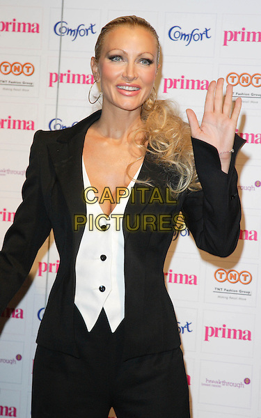 CAPRICE BOURRET.Prima High Street Fashion Awards, Evolution, Battersea Park, London, England. .September 13th, 2007 .half length black jacket white waistcoat suit hand palm waving cleavage hoop earrings .CAP/ROS.©Steve Ross/Capital Pictures
