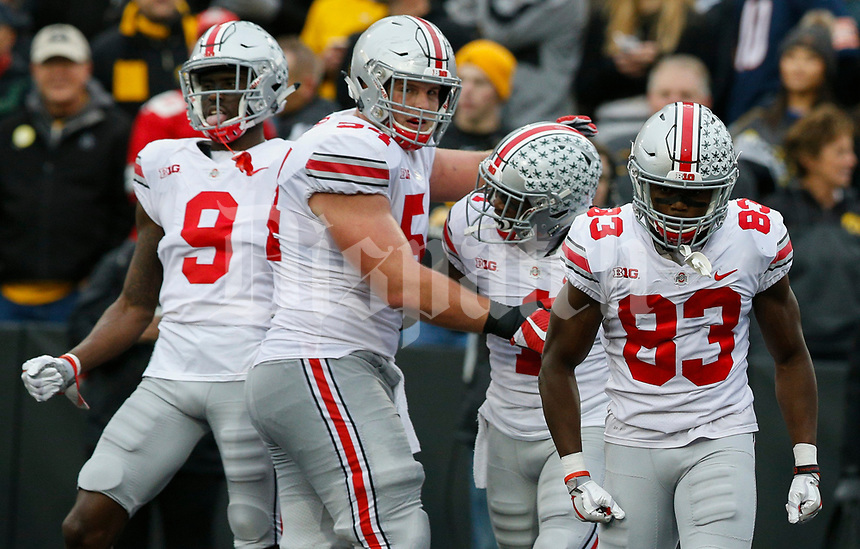 Ohio State Buckeyes offensive lineman Billy Price (54) celebrates with Ohio State Buckeyes wide receiver Johnnie Dixon (1) after Dixon scored a touchdown during the second quarter of a NCAA college football game between the Iowa Hawkeyes and the Ohio State Buckeyes on Saturday, November 4, 2017 at Kinnick Stadium in Iowa City, Iowa. [Joshua A. Bickel/Dispatch]