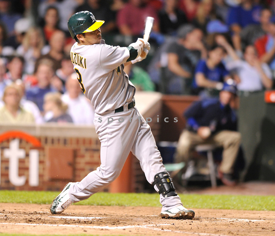 KURT SUZUKI,  of the Oakland A's  in action  during the A's game against the Chicago Cubs .  The A's beat the Cubs 10-2 in Chicago, Illinois on June 15, 2010...DAVID DUROCHIK / SPORTPICS