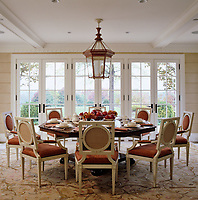 In this bright and spacious garden dining room foliage is a feature of the intricate design of the carpet