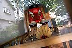 Photo shows a large Tengu mask used in the Tengu Festival at a shrine in Shimokitazawa in Setagaya Ward, Tokyo, Japan..Photographer: Robert Gilhooly