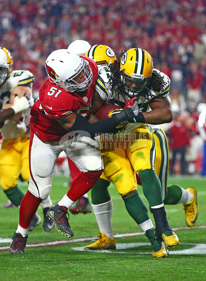 Jan 16, 2016; Glendale, AZ, USA; Green Bay Packers running back Eddie Lacy (right) is tackled by Arizona Cardinals linebacker Kevin Minter in a NFC Divisional round playoff game at University of Phoenix Stadium. Mandatory Credit: Mark J. Rebilas-USA TODAY Sports