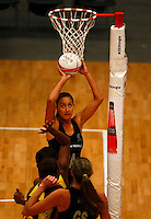 17.1.2014 New Zealand's Maria Tutaia puts up a shot against Jamaica during their netball test match in London, England. Mandatory Photo Credit (Pic: Tim Hales). ©Michael Bradley Photography.