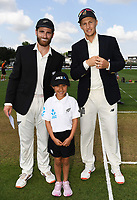 29th November 2019, Hamilton, New Zealand;  Captains Kane Williamson and Joe Root with ANZ coin toss competition winner on day 1 of the 2nd international cricket test match between New Zealand and England at Seddon Park, Hamilton, New Zealand. Friday 29 November 2019