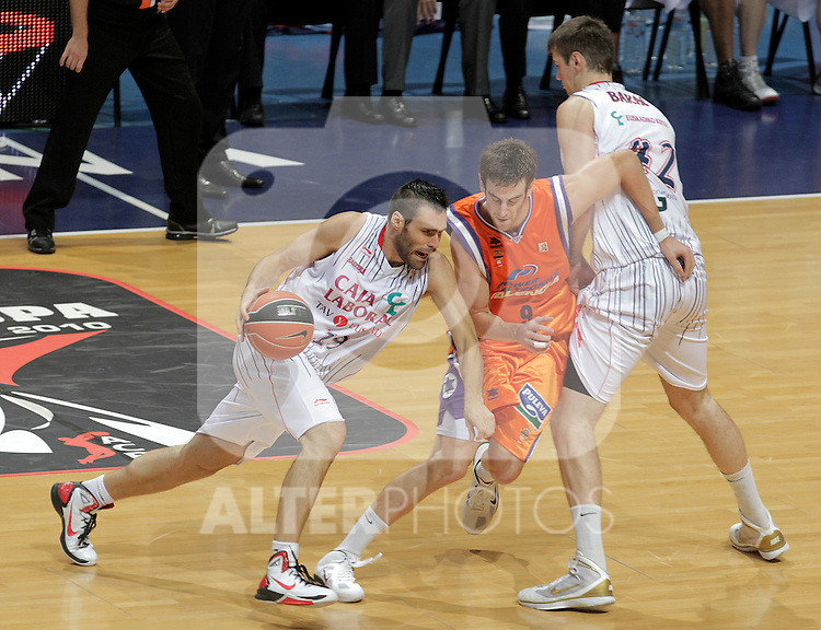 Caja Laboral Baskonia's Fernando San Emeterio (l) and Stanko Barac (r) and Power Electronics Valencia's Victor Claver during ACB Supercup Semifinal match.September 24,2010. (ALTERPHOTOS/Acero)
