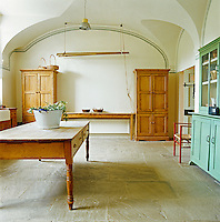 The basement kitchen retains its original stone-flagged floor and pine furniture