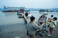 Passengers leaving Victoria 3 to visit the old town, now being flooded 130 meters deep starting 2002 by Three Gorges Dam.