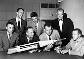 "The Original 7 Mercury Astronauts are pictured around a table admiring an Atlas model on April 30, 1959. Standing, left to right are Alan B. Shepard, Jr., Walter M. Schirra, Jr., and John H. Glenn, Jr.; sitting, left to right are Virgil I. Grissom, M. Scott Carpenter, Donald Slayton, and L. Gordon Cooper, Jr.   The Mercury 7 astronauts were introduced to the American public in April 1959. The seven criteria for selection were as follows: 1. less than 40 years old; 2. less than 5 foot 11 inches tall: 3. excellent physical condition; 4. bachelor's degree in engineering or equivalent; 5. test-pilot school graduate; 6. minimum of 1,500 hours flying time; 7. qualified jet pilot. However, the process of choosing the first astronauts was elaborate and rigorous. The Langley Space Task Group believed that one of the most important prerequisites was being a test pilot. Langley engineer Charles Donlan and test pilot Robert Champine played important roles in the screening and selection process. Once selected, the astronauts began their training program at Langley. This included a ""little of everything"" ranging from a graduate-level course in introductory space science to simulator training and scuba-diving. Training continued until the Langley Space Task Group was transferred to Houston, Texas..Credit: NASA via CNP"