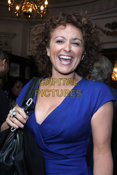 NADIA SAWALHA.'Pygmalion' Press Night at the Garrick Theatre, London, England..May 25th 2011.half length purple blue wrap dress mouth open smiling laughing .CAP/ROS.©Steve Ross/Capital Pictures