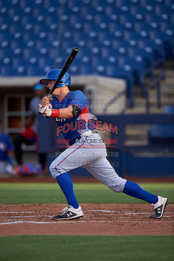 AZL Rangers designated hitter Josh Jung (18) hits a single to center field during an Arizona League game against the AZL Brewers Blue on July 11, 2019 at American Family Fields of Phoenix in Phoenix, Arizona. The AZL Rangers defeated the AZL Brewers Blue 5-2. (Zachary Lucy/Four Seam Images)