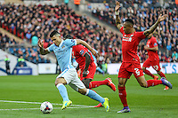 Sergio Aguero of Manchester City gets away from Nathaniel Clyne of Liverpool (right) during the Capital One Cup match between Liverpool and Manchester City at Wembley Stadium, London, England on 28 February 2016. Photo by David Horn / PRiME Media Images.