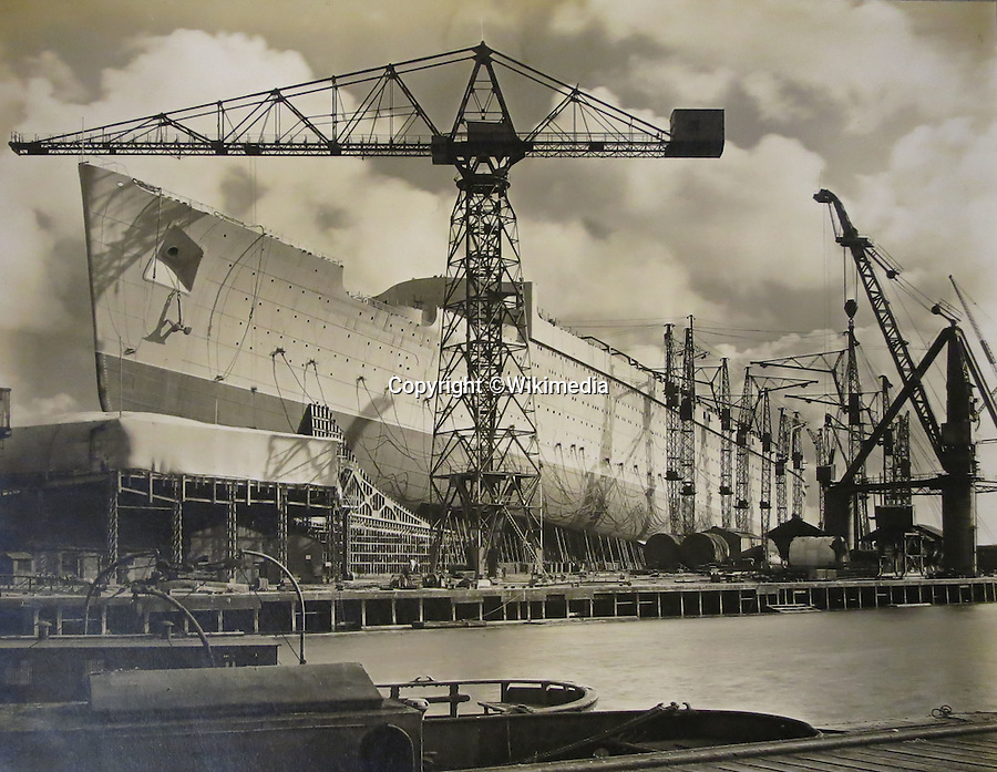 BNPS.co.uk (01202 558833)<br /> Pic CharlesMiller/BNPS<br /> <br /> The massive ship near's completion in 1934.<br /> <br /> One of the largest flags in the world, that once graced the bow of the Queen Mary during WW2, is being sold by auctioneer Charles Miller in London.<br /> <br /> At 36 feet by 17, the huge blue ensign is the size of a double decker bus, and was flown by the famous liner when she served as a troopship during the war.<br /> <br /> The Queen Mary held the prestigious Blue Riband for the fastest Atlantic crossing from 1936 to 1952, and now is run as a hotel in Long Beach, California.