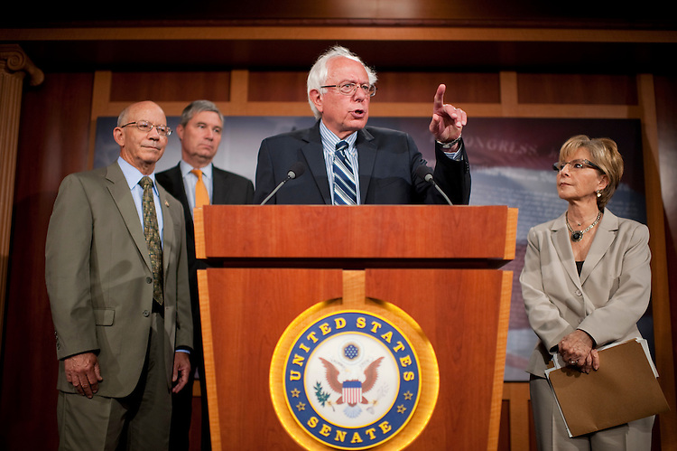 UNITED STATES - SEPTEMBER 14:  From left, Rep. Pete DeFazio, D-Ore., Sens. Sheldon Whithouse, D-R.I., Bernie Sanders, I-Vt., and Barbara Boxer, D-Calif., conduct a news conference in the Capitol to introduce legislation that would support Social Security by raising the payroll tax, which funds the system.  (Photo By Tom Williams/Roll Call)