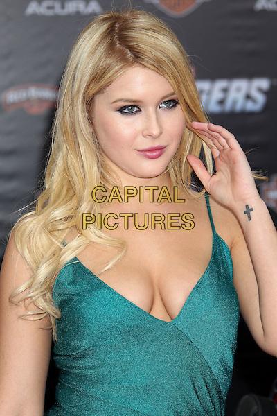 "Renee Olstead.""Marvel's The Avengers"" World Premiere held at the El Capitan Theatre, Hollywood, California, USA..April 11th, 2012.headshot portrait green cleavage half length hand arm cross crucifix tattoo.CAP/ADM/RE.©Russ Elliot/AdMedia/Capital Pictures."