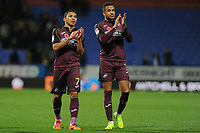 Jefferson Montero (left) and Martin Olsson (right) of Swansea City applauds the fans at the final whistle of the Sky Bet Championship match between Bolton Wanderers and Swansea City at the Macron Stadium in Bolton, England, UK. Saturday 10 November 2018