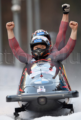 27.02.2016. Koenigssee,  Berchtesgaden, Germany. Yunjong Won and Youngwoo Seo of Korea celebrate as they cross the finish line during the two-man bobsleigh race at the Bobsleigh World Cup in Koenigssee, Germany, 27 February 2016. Won and Seo came first, both in the race and in the overall world cup.