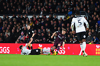 Decland John of Swansea City is tackled by Craig Bryson of Derby County during the Sky Bet Championship match between Derby City and Swansea City at the Pride Park Stadium in Derby, England, UK. Saturday 01 December 2018