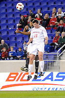 Greg Davis (14) of the Providence Friars and Alex Hadley (23) of the Cincinnati Bearcats. The Providence Friars defeated the Cincinnati Bearcats 2-1 during the semi-finals of the Big East Men's Soccer Championship at Red Bull Arena in Harrison, NJ, on November 12, 2010.