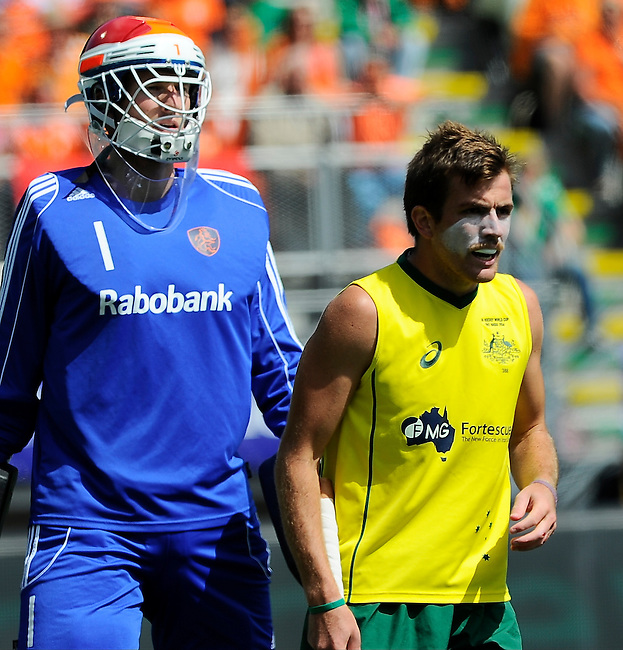 The Hague, Netherlands, June 15: Jaap Stockmann #1 of The Netherlands and Jacob Whetton #12 of Australia look on during the field hockey gold match (Men) between Australia and The Netherlands on June 15, 2014 during the World Cup 2014 at Kyocera Stadium in The Hague, Netherlands. Final score 6-1 (2-1)  (Photo by Dirk Markgraf / www.265-images.com) *** Local caption ***