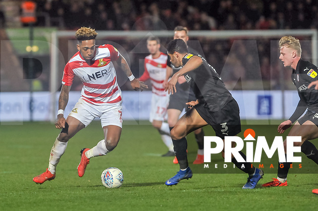 Doncaster Rovers forward Malik Wilks (7) takes on Barnsley's defender Zeki Fryers (3) during the Sky Bet League 1 match between Doncaster Rovers and Barnsley at the Keepmoat Stadium, Doncaster, England on 15 March 2019. Photo by Stephen Buckley / PRiME Media Images.