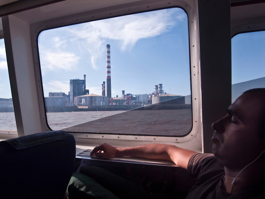 Man taking a nap on the ferry ride from Montevideo, Uruguay to Buenos Aires, Argentina.