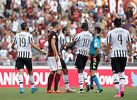 Calcio, Serie A: Roma vs Juventus. Roma, stadio Olimpico, 30 agosto 2015.<br /> Referee Nicola Rizzoli, second from right, shows a red card to Juventus&rsquo; Giorgio Chiellini, third from left, during the Italian Serie A football match between Roma and Juventus at Rome's Olympic stadium, 30 August 2015.<br /> UPDATE IMAGES PRESS/Isabella Bonotto