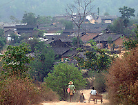 Benglong village near Banlao in western Yunnan just 40 miles from the Burmese border. Half of the males in this village have been executed for drug smuggling offences. The area is famed for the number of desperately poor people that make a living by smuggling drugs from Burma into China. ..PHOTO BY SINOPIX
