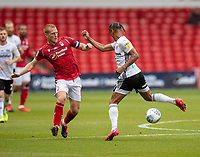 7th July 2020; City Ground, Nottinghamshire, Midlands, England; English Championship Football, Nottingham Forest versus Fulham; Ben Watson (C) of Notts Forest and Bobby Reid of Fulham challenge for the ball