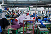 July 14, 2009 - Phnom Penh, Cambodia. Garment factory workers during a lunch break. © Nicolas Axelrod / Ruom