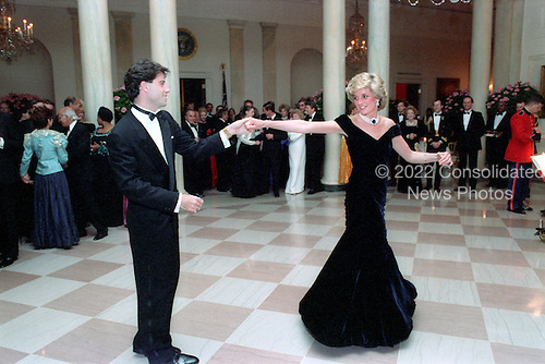 In this photo provided by the Ronald Reagan Presidential Library, Princess Diana dances with John Travolta in the Cross Hall of the White House in Washington, D.C. at a Dinner for Prince Charles and Princess Diana of the United Kingdom on November 9, 1985.<br /> Mandatory Credit: Pete Souza - Courtesy Ronald Reagan Library via CNP