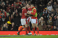 Wales Josh Adams celebrates scoring his sides fifth try with team-mates Wales Wyn Jones and Sam Davies<br /> <br /> Photographer Ian Cook/CameraSport<br /> <br /> 2019 Autumn Internationals - Wales v Barbarians - Saturday 30th November 2019 - Principality Stadium - Cardifff<br /> <br /> World Copyright © 2019 CameraSport. All rights reserved. 43 Linden Ave. Countesthorpe. Leicester. England. LE8 5PG - Tel: +44 (0) 116 277 4147 - admin@camerasport.com - www.camerasport.com