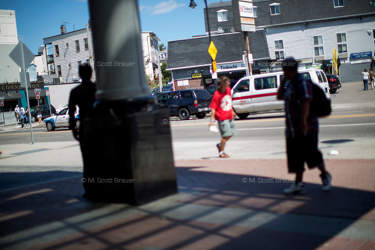 A view of Andrew Square near the Andrew T stop in South Boston, Massachusetts, USA. South Boston has the largest problem with heroin addiction in the Boston area. Andrew Square, at the border between South Boston and Dorchester with a Red Line T stop and close to downtown, is a hot spot for heroin usage, despite recent gentrification. There are a number of methadone clinics in the area, as well.