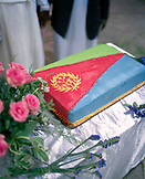 ERITREA, Asmara, Independence Day Celebration cake decorated like the Eritrean flag at the Zoba Makel in Gegabanda
