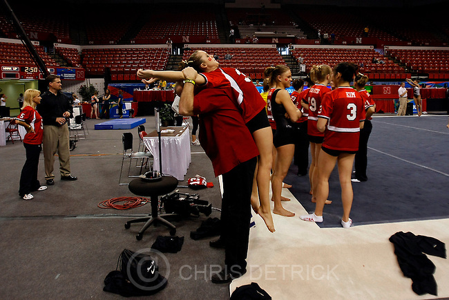 Utah coach Greg Marsden helps to stretch Stephanie McAllister before the 2009 National Collegiate Women's Gymnastics Championships at the University of Nebraska's Bob Devaney Sports Center Thursday, April 16, 2009. ..Chris Detrick/The Salt Lake Tribune