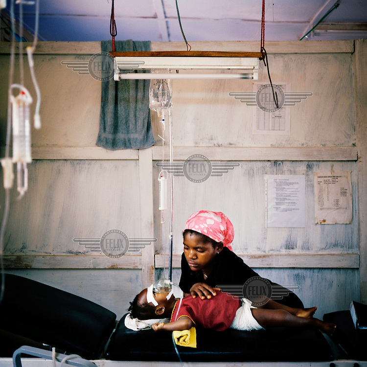 A malaria patient and his mother in the ICU (intensive care unit) at MSF (Medecins sans Frontieres) Gondama hospital in Bo.