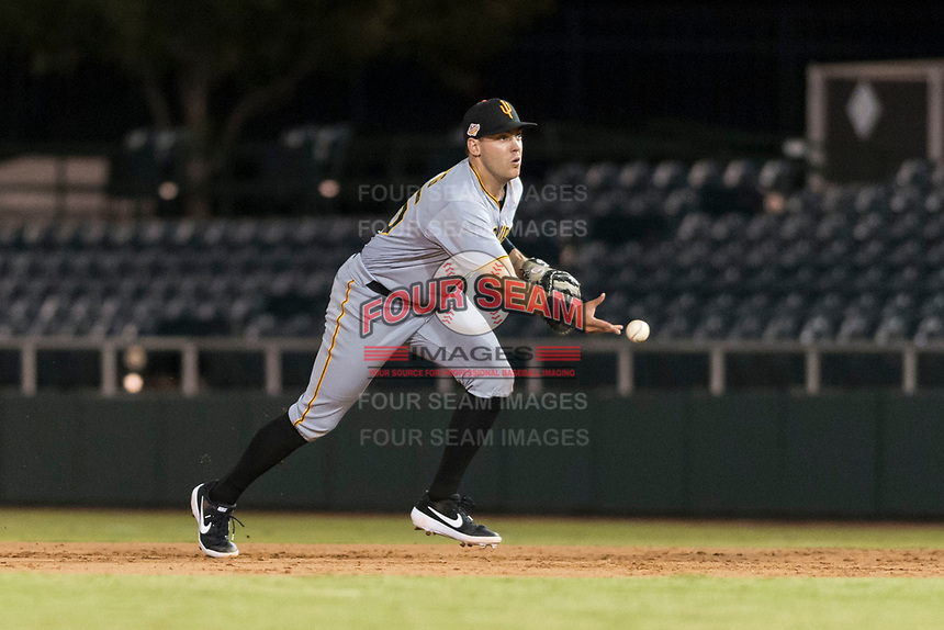 Surprise Saguaros first baseman Will Craig (45), of the Pittsburgh Pirates organization, flips to the pitcher covering the base during an Arizona Fall League game against the Scottsdale Scorpions at Scottsdale Stadium on October 15, 2018 in Scottsdale, Arizona. Surprise defeated Scottsdale 2-0. (Zachary Lucy/Four Seam Images)