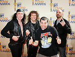 UNIVERSAL CITY, CA. - May 31: (L-R) Musicians Glenn Five, Steve 'Lips' Kudlow and Robb Reiner of Anvil with TV personality Steve-O (2ndR) arrive at the 2009 MTV Movie Awards held at the Gibson Amphitheatre on May 31, 2009 in Universal City, California.